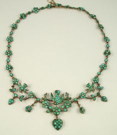 Victorian circa 1870-1880   Pavé-set small Persian turquoise cabochons were used extensively both in the 1840s and then, in the 1870s.      Superb turquoise necklace with motifs of hearts, flowers with pearl centers and birds (with ruby eyes), originally gilt over silver.  Marked 800D.