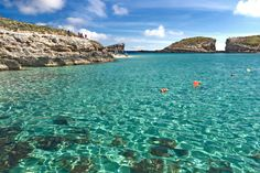 Sea cliffs and limestone caves surround the Blue Hole of Comino in the Maltese Islands