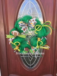 A personal favorite from my Etsy shop https://www.etsy.com/listing/501050619/green-bay-packer-wreath-football-wreath