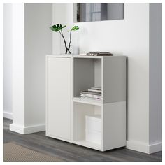 EKET Storage combination with feet, white/gray. With the EKET series you can build your storage big, small, colorful or discreet to either display or hide your things. And if your space and needs change, you can easily change your EKET solution too. Cube Storage Unit, Ikea Storage, Storage Spaces, Tall Cabinet Storage, Locker Storage, Entrada Ikea, Ikea Eket, Flexible Furniture, Ikea Living Room