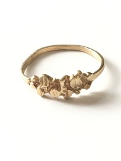 A personal favorite from my Etsy shop https://www.etsy.com/listing/463602610/10k-gold-jsc-gold-nugget-ring-size-8-12