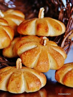 Make a roll look just like a pumpkin....literally. These are simple frozen dough rolls sliced and cut to look like a pumpkin with a pecan for a stem.