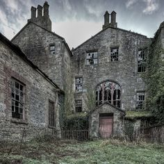 a traveler took shelter from the rain in an old building.    County Tyrone, Northern Ireland.