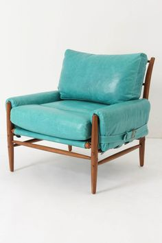 Turquoise leather club chair. Oh my.
