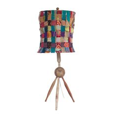 A playful and vibrant mashup of recycled kantha-embroidered fabric makes this lamp's shade a unique work of art. And with a base made of recycled wooden rolling pins, it's a quirky cool way to inject a little East Indian flair to your space.