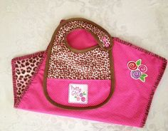 Just made this bib and changing Pad with Sassy Cheetah from Babyville Boutique.  www.babyvilleboutique.com