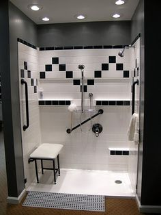Best Bath Systems walk-in shower...black and white custom colour and barrier-free accessory package. Ramp allows roll-in access from a wheelchair or walker. www.aquassure.com