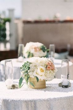 @Chrissy L botak  Is something like this possible, but with the square vase you showed me?    succulents + pink flowers + white linens / beach wedding reception centerpiece