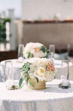 succulents + pink flowers + white linens / beach wedding reception centerpiece