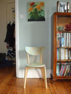 Cover a wooden chair in old maps. Via ikeahackers.net