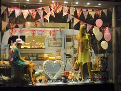 A colorful, summer themed window display on Oxford Street, London.