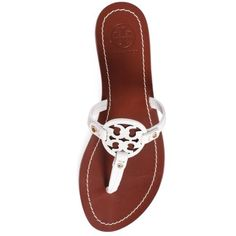 *NIB* Tory Burch 'Mini Miller' Flat Sandal From poolside hangouts to city shopping, Tory Burch's laser-cut logo sandals are a laid-back yet elegant addition to your summer wardrobe. Thong, slip on. Synthetic upper, lining and sole. True to size. Tory Burch Shoes Sandals