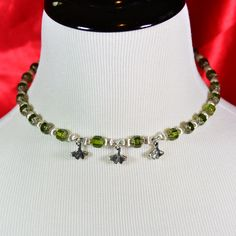 Embrace your inner tree-hugger with a ginkgo-charm jewelry set. This memory wire choker and its matching earrings are festooned with translucent, silver-tipped green cathedral cut and silver fire-polished Czech glass beads. The ginkgo charms are solid, two-sided TierraCast silver. The earrings are 2 1/2 inches long. Each piece makes a striking impression on its own. The effect is doubled when worn together. $25. Buy now at #SmallestPlanet.
