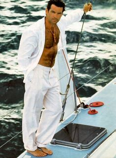 Pierce Brosnan.  Did you know men weren't allowed to be photographed in the eighties unless they exposed some chest hair while riding on a yacht?