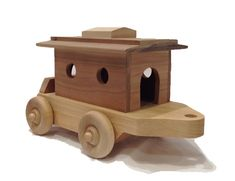The Hardwood Toys large wooden toy train includes a large wooden toy caboose to carry the two little wooden toy people. The roof is easily removed so the people can get in and out. The large wooden toy train caboose is long x wide. Made in the USA. Wooden Toy Train, Popular Hobbies, Toy People, Model Train Layouts, Train Set, Model Trains, Toy Trains, Wood Toys, Classic Toys
