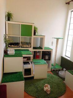 An IKEA hack/cat apartment/storage shelves made of KALLAX shelving.