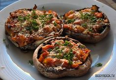 Portobello mushroom pizzas: Sautee chopped onion, tomato, spinach, mushroom and bell pepper with some olive oil, add some garlic and a little Italian seasoning. Place a couple of large Portobello mushrooms on a greased pan with the caps down. Then, pile on your veggies. Bake at 400 degrees F for about 10-12 minutes. Sprinkle on some Italian cheese and bake until cheese is well melted.