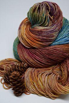 Colorway: Dance in the Sun  Hand Dyed by Christina  75% Superwash Merino Wool / 20% Nylon / 5% Stellina 438 yards / 100 grams Fingering