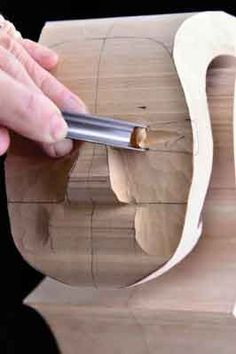 Step 2: use a No.9,10mm gouge to pare away the wood, between the upper and lowermost position of the eyes on the front view, down to the depth of the forward most position of the eyes that you marked on the side view