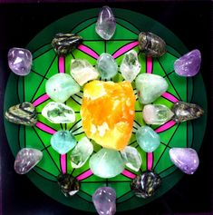 "Crystal grid for Healing Orange Calcite (center) - cleanses and sooths the body 6 Clear Quartz points- dispels illness, and amplifies healing 3 Prehnite- gently relieves symptoms of illness, and heals the direct cause 3 Green Fluorite- sucks up unwanted illness, and gives you clarity 6 Amethyst- aka the ""Master Healer,"" absorbs toxic energies 6 Serpentine- releases the root cause of any dis-ease"