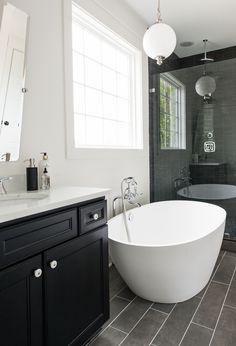 Designer Bathroom Lighting Fixture in Covington by Crescent Homes Bathroom Light Fixtures, Bathroom Lighting, Electrical Plan, New Home Designs, Clawfoot Bathtub, Contemporary Decor, Bathroom Inspiration, Home Lighting, Modern Bathroom