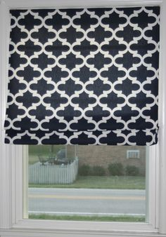 Turn inexpensive mini blinds into a polished looking Roman shade in no time at all.