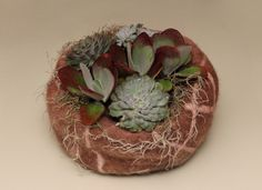 #felt ball made of felt with carded Bergschaf wool natural brown and bamboo tops link. Photo Judith Byberg