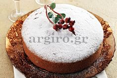 Vasilopita is a traditional Greek cake or bread served on New Year's to celebrate the life of Saint Basil. After baking the cake, a coin is inserted t. Vasilopita Cake, Greek Desserts, Greek Recipes, Greek Cake, New Year's Eve Appetizers, New Year's Cake, New Year's Food, Christmas Sweets, Kitchens
