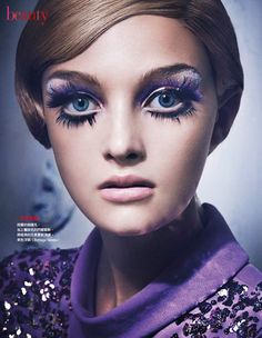 Okay, so this isn't from the 60s, but the haircut and the eye makeup totally reminds me of Twiggy.
