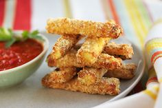 Parmesan Panko Zucchini Fries   Parmesan Panko Zucchini Fries    ½ cup all-purpose flour  1 egg  ¼ cup dried bread crumbs, such as Progresso  ¼ cup Parmigiano Reggiano  ¼ cup Panko bread crumbs  Kosher salt to taste    2 large zucchini squash, cut into ¾-inch batons, about 4 inches long,