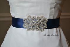 Bridal sashes are so popular right now! This beautiful ELIZABETH rhinestone and beaded applique is attached to a double faced satin ribbon