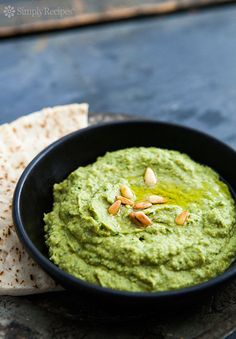 Basil Hummus ~ Basil hummus dip made with garbanzo beans, puréed with fresh basil, olive oil, toasted pine nuts, garlic, and lemon. ~ SimplyRecipes.com
