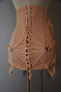 vintage 50s pink corset. i have one that is almost exact to this that i found in a thrift store...just cant find it. :(