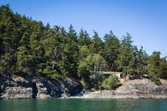 Seeking a quiet retreat, a couple builds a 1,600-square-foot property where simplicity reigns.  Although there was no home on this piece of rugged shoreline in Washington State's San Juan Islands National Monument, a couple held strong ties to the site. They had owned the land for seven years by the time they contacted Heliotrope Architects. Principal Joseph Herrin sums up their request for construction with a succinct adage: they wanted a property that presented quality over quantity. The…