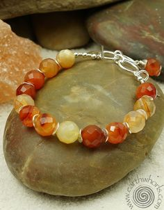 https://earthwhorls.com/products/3103sb  Carnelian and sterling silver bracelet by EarthWhorls.  $55.00 One of a kind, handmade, free shipping.