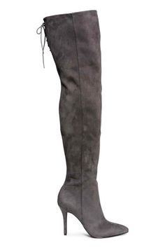 Thigh boots: Thigh boots in imitation suede with a high elastic shaft with lacing at the top and a half-zip in the side. Covered heels, imitation leather insoles and rubber soles. Heel 10 cm.
