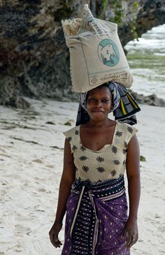 Zanzabar, Tanzania > I would guess these precious women get headaches and backaches from carrying these heavy items.