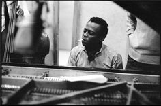 """Miles Davis, 1959 © DON HUNSTEIN, 1959. During the """"Kind of Blue"""" sessions, Miles Davis provided his sextet with a schematic framework for the modal improvisations that would comprise the album. A rare shot of Miles at the keyboard. Columbia Records 30th Street Studios NYC"""