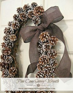 simple ribbon treatment for pine cone wreath