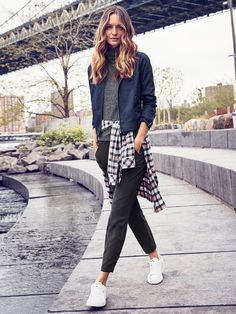 Make your track pants and zip ups feel a little less Friday-night-in with the help of a turtleneck. Matching it with a slim-cut pair of sweats and windbreaker makes for a chic and fashion forward outfit, especially if you layer your look with the help of plaid tied around your waist.