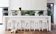 white kitchen with awesome splashback window