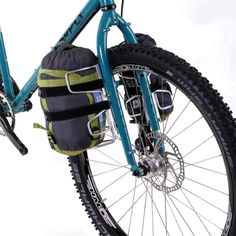 The Passport Lug-Kage is a lightweight variation on a front fork carrier It allows you to Lug such extra items as a sleeping bag an Airbed a large Cycle Chic, Bike Bag, Tarpaulin, Fat Bike, Touring Bike, Bicycle Components, Bicycle Accessories, Sleeping Bag, Velcro Straps