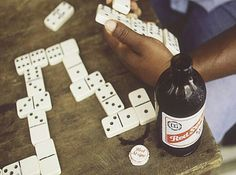 Dominoes with Red Stripe beer