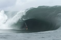 Alex Gray in the belly of the beast during the Code Red swell of 2011, which once again redefined what was possible at the end of the road. Photo: Glaser