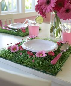 Green Grass Mat- could recreate w/ fake grass & some fake flowers, could be a cute way to display strawberry topiaries & rainbow fruit