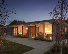 a view of the renovated Eichler from the far corner of the backyard by night