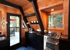 A Frame cabin via Popp Littrell Architecture in Sacramento, CA A Frame Cabin, A Frame House, Slanted Walls, Slanted Ceiling, Cabin Kitchens, House Ideas, Cozy Cabin, Tiny House Design, Small Patio