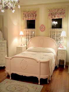 Pink vintage room with full size bed mildly distressed & refinished in a linen white. Curved head & foot board, create soft lines.