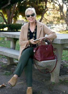 Checking my messages. Wearing J.Crew sweater blazer, Longchamp bag. Details at une femme d'un certain age.