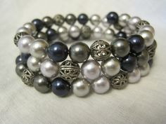 Bridesmaid bracelet made from Swarovski pearls and silver beads strung on memory wire.